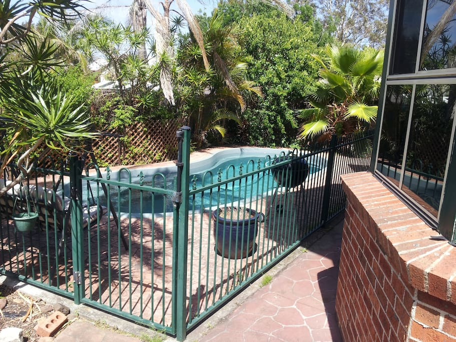 Intimate back yard pool area, security gate, excellent for kids or adults