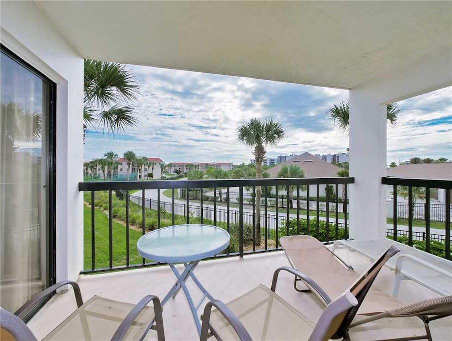 Visit the beautiful balcony for a breath of fresh Florida air. - The beautiful balcony, complete with palm tree views, is an all-