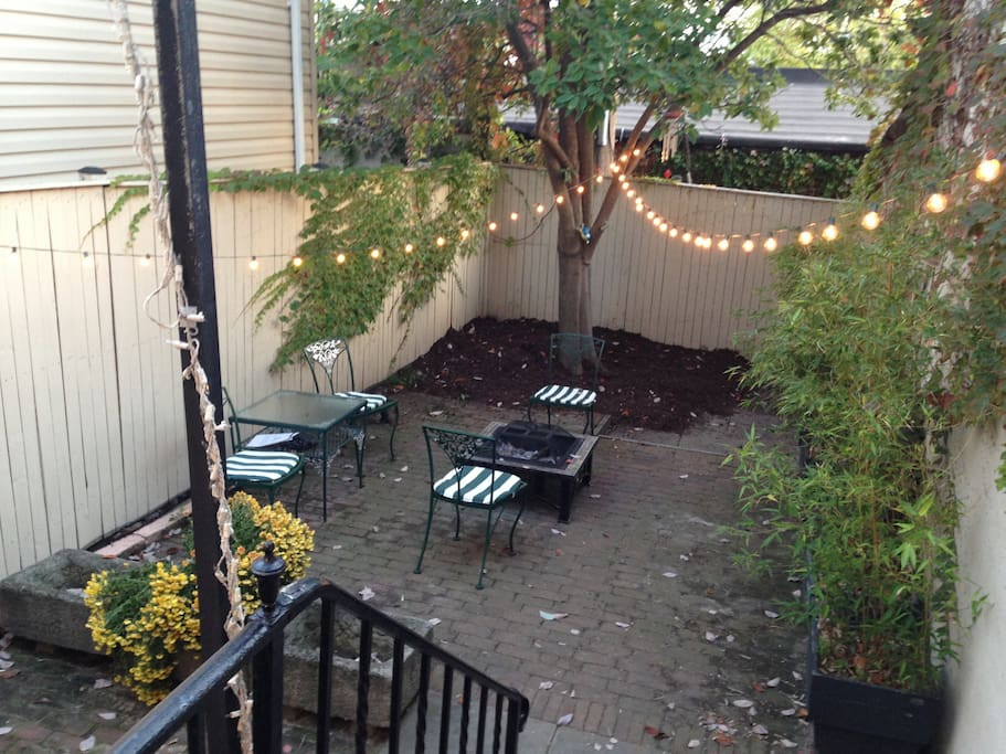 Rare Baltimore back patio with fire pit! Magnolia tree blooms in spring!
