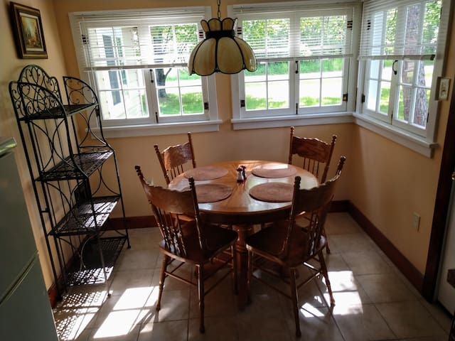 Bright cheery dining area for that morning cup of coffee.