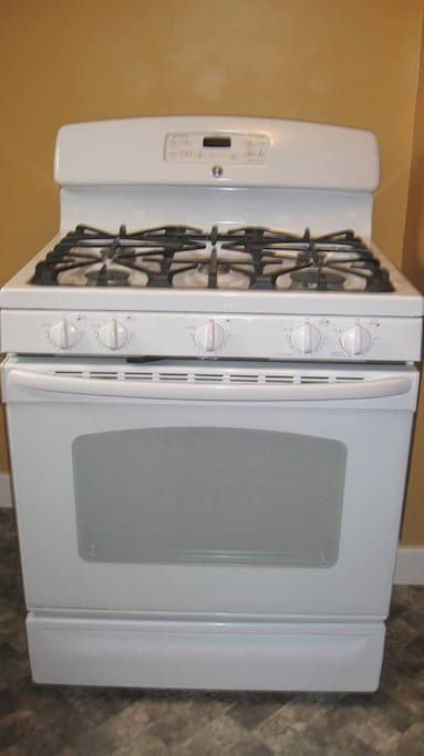 New fiver burner gas stove, and oven.