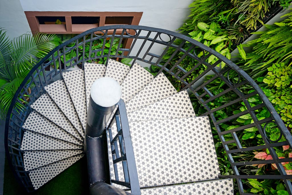 View of spiral staircase to rooms.