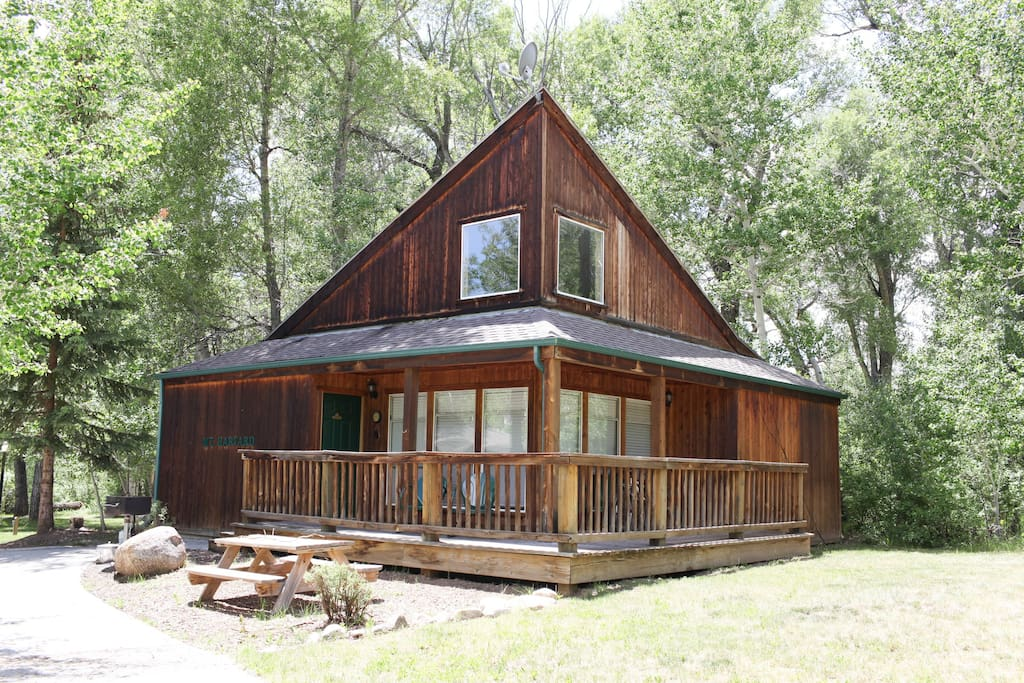 Mt. Harvard Chalet has a wrap around deck, grill, picnic table and beautiful grassy area in front of the creek.