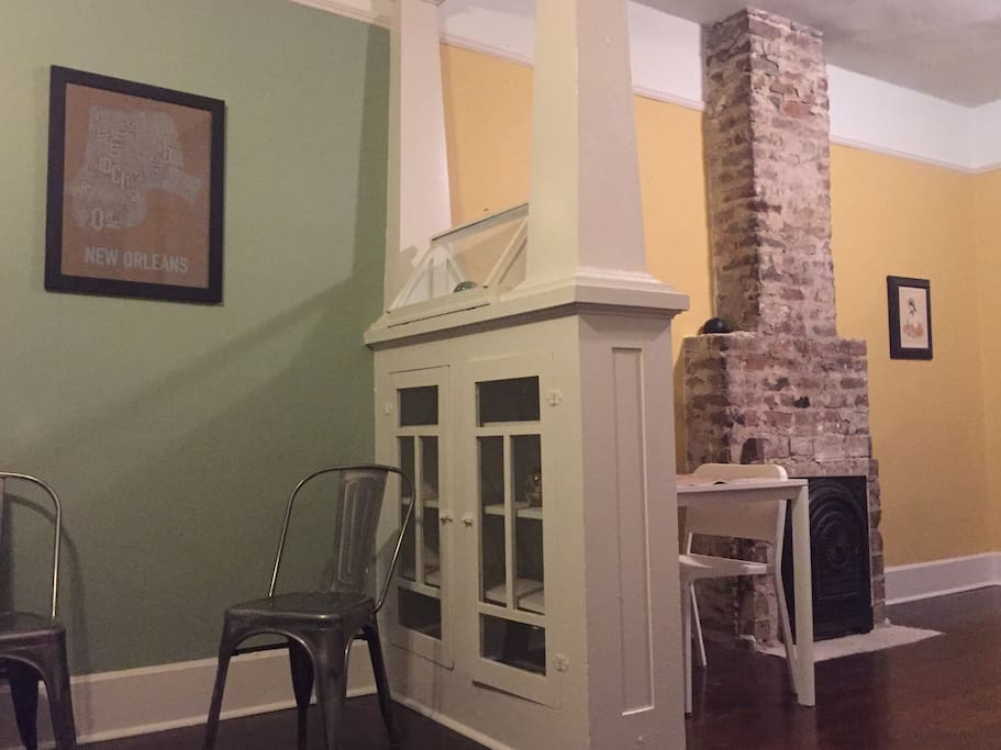 Built in Craftsmen cabinets and uniquely shaped chimney.