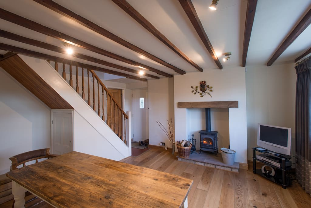 Dining area with exposed beams, underfloor heating and wood burner...