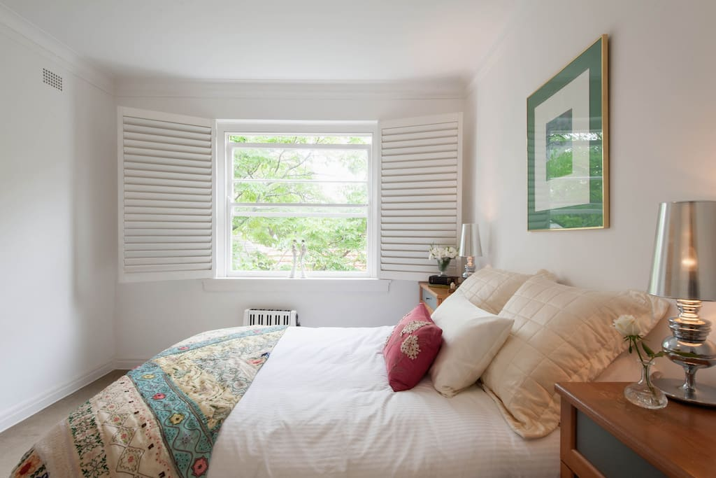 Quiet, leafy outlook with luxury Sealy Posturepedic Queen sized bed and built-in wardrobes