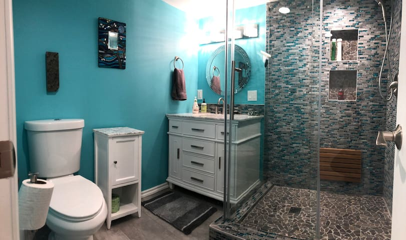 Full bathroom with shampoo, conditioner, soap, first aid supplies, and other bathroom basics, as well as lots of big, fluffy towels!