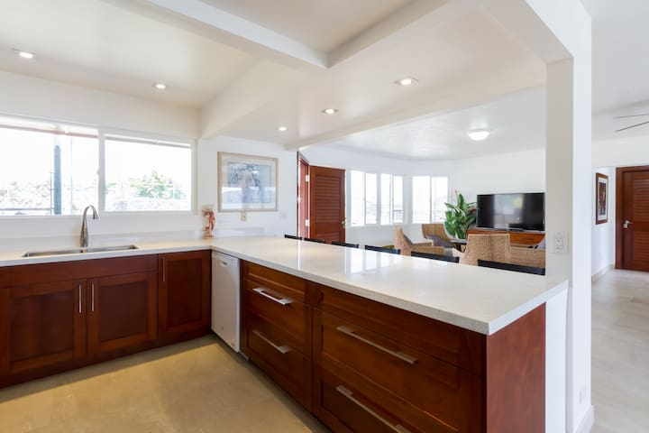 The kitchen has ample counter space for preparing meals. It is bright and spacious for families to cook together.