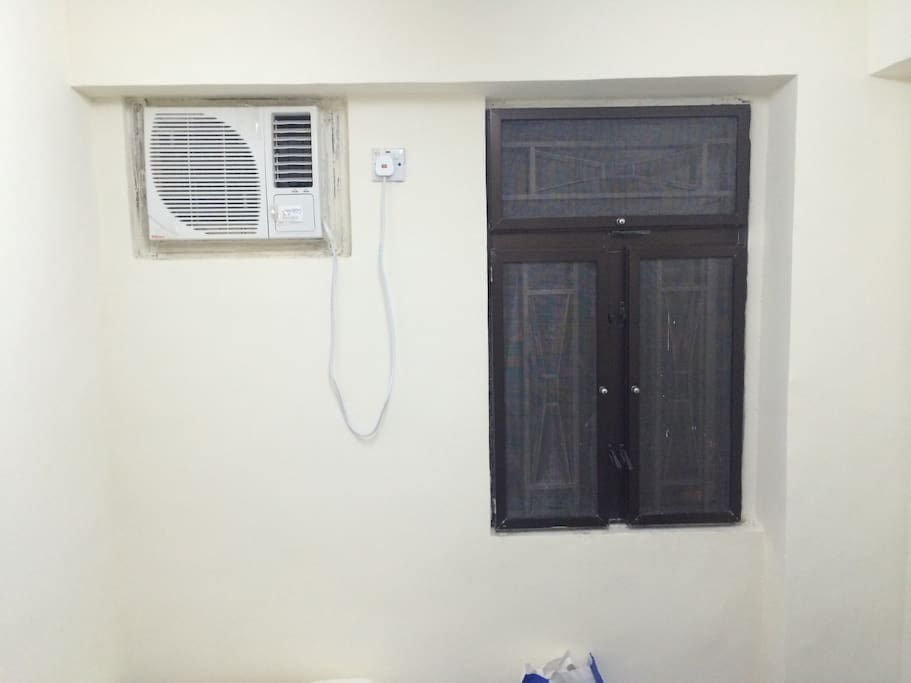 Room with aircon and window