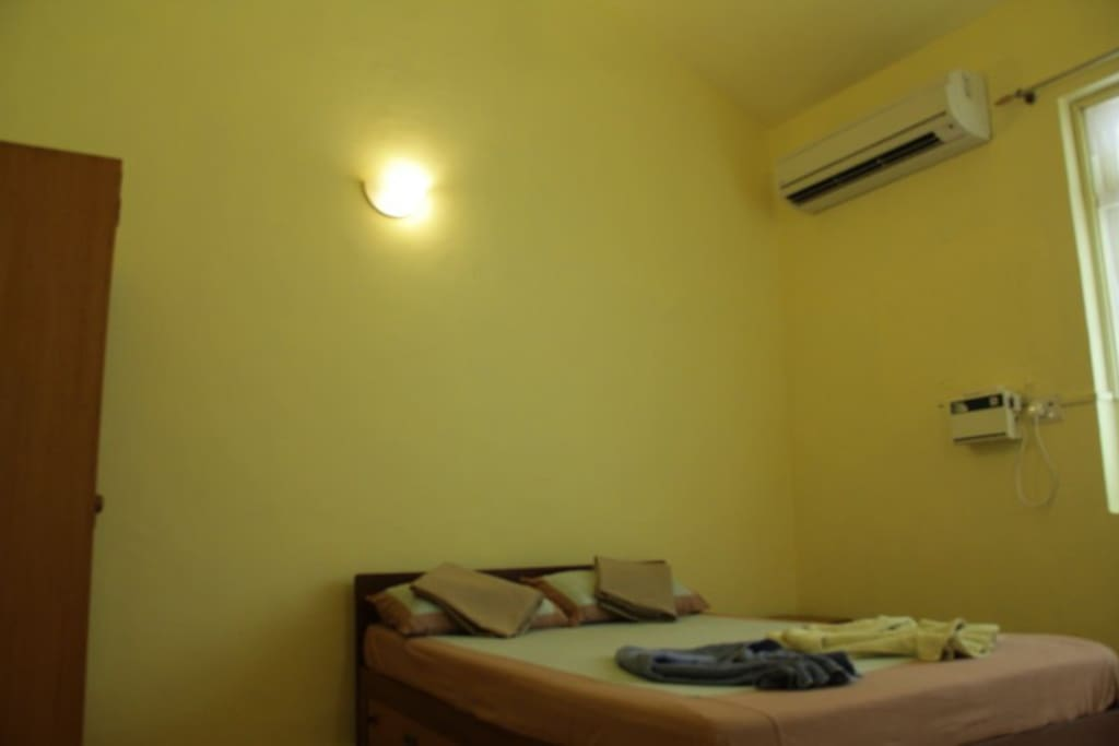 Bedroom fitted with Daikin 5 star AC and attached balcony.