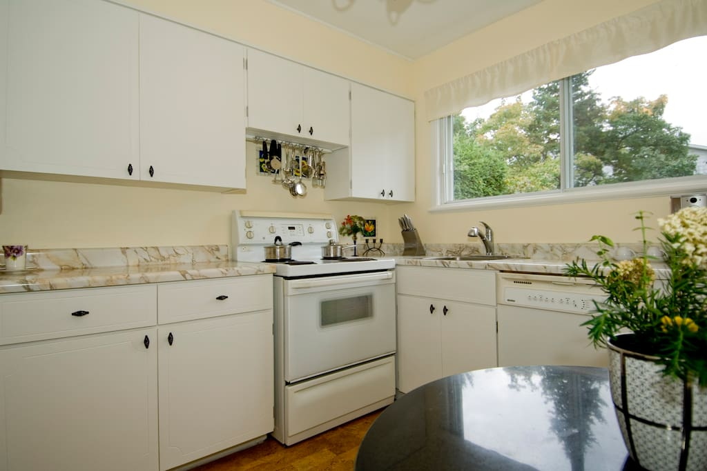 Kitchen with fridge and cupboard space for you. Breakfast table.