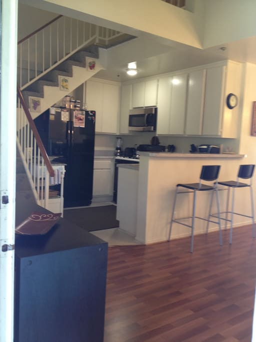 As you enter the apartment, view of kitchen area