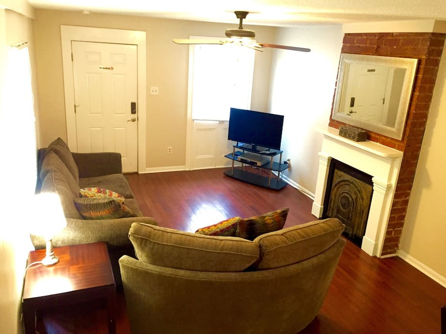 Spacious living room with plenty of comfortable seating.