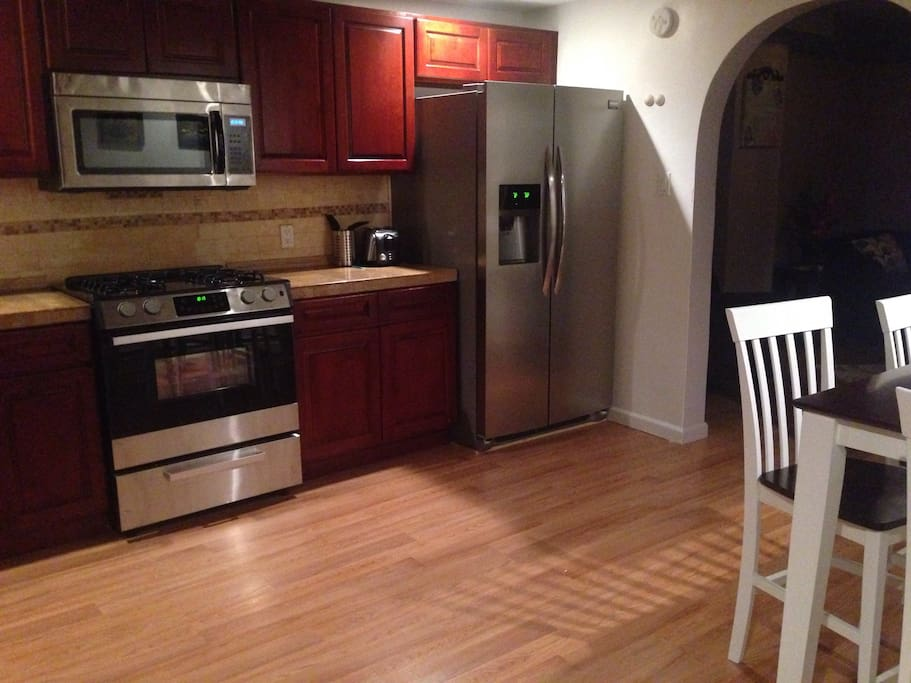 Beautiful and spacious kitchen with all stainless steel appliances