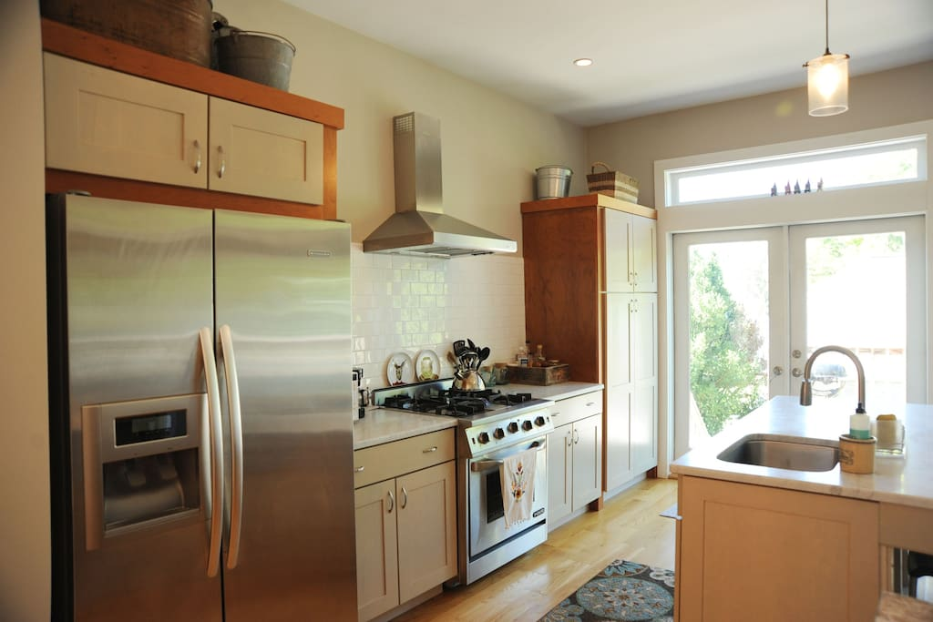 Sunny open kitchen w/ island perfect for creating your own Farm to Table Feast. All new gourmet appliances, huge side by side refrigerator, Gas Stove/ oven, Dishwasher, microwave, 10 cup coffee machine, toaster, blender & more