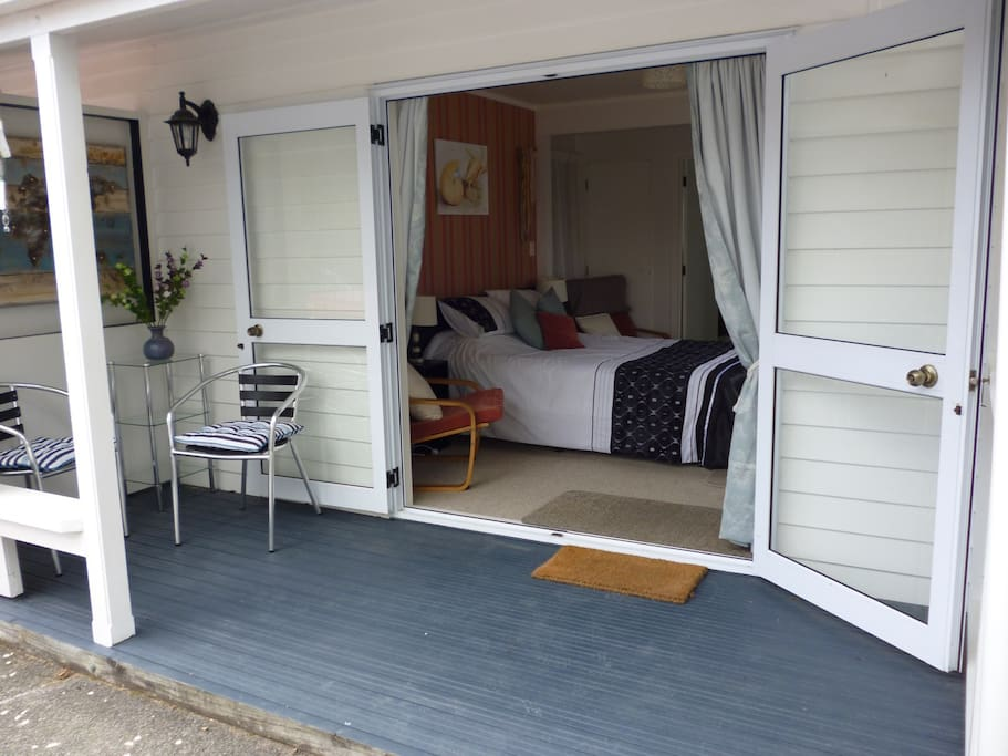 Apartment deck with doors open to see inside