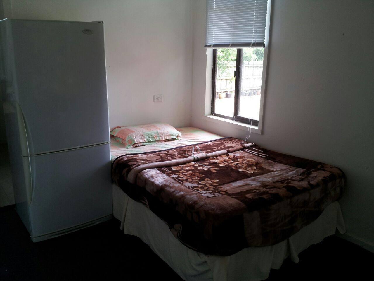 Bedroom having fridge as well