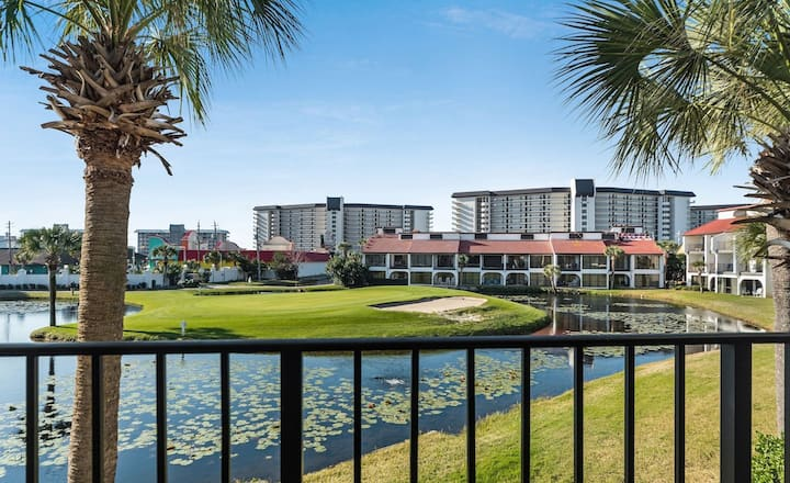 New: Beautiful bi-level golf villa condo overlooking the green! 11 pools, WiFi!