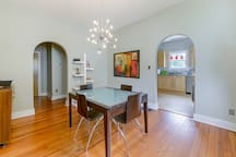 Dining Room with extendable table to seat 8-10. Arches lead to kitchen on the right and bedrooms on the left.