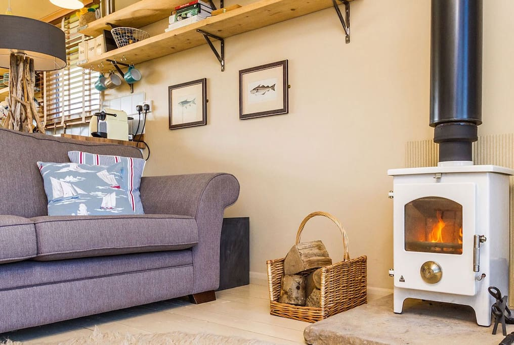 Cosy up by the log stove in the evenings and enjoy the lake view (or a movie or two)
