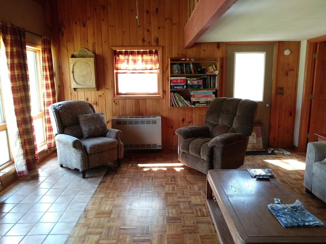 2nd living room with comfy chairs.  Roku large screen TV included