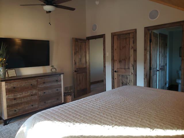 Guest room, dresser, TV and closet.