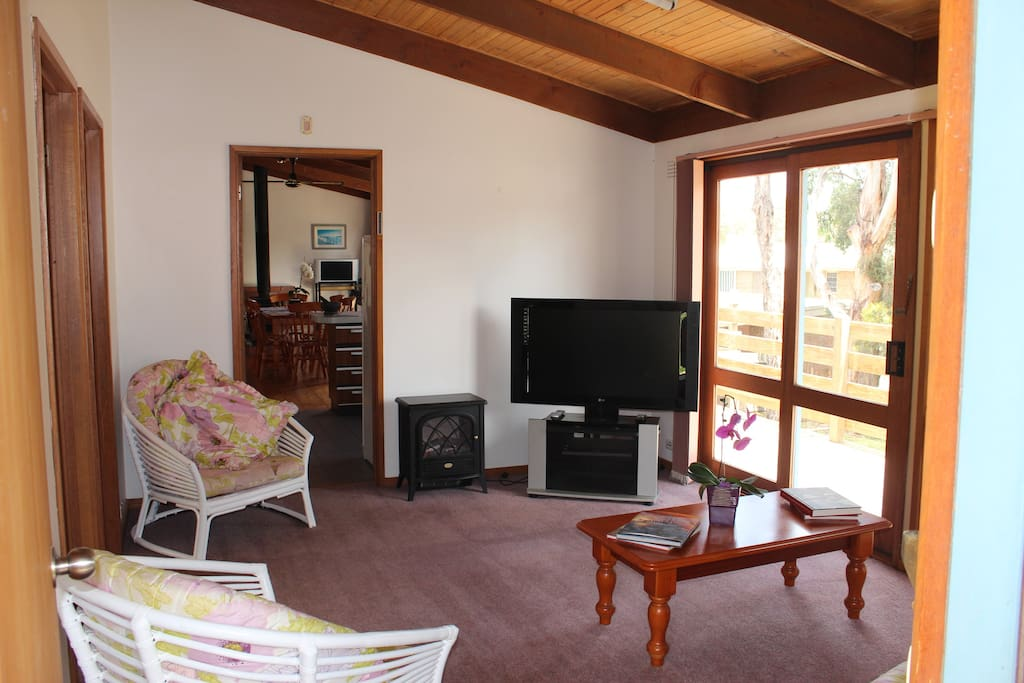 Lounge room - with LCD TV; video player; electric heater; air conditioner.
