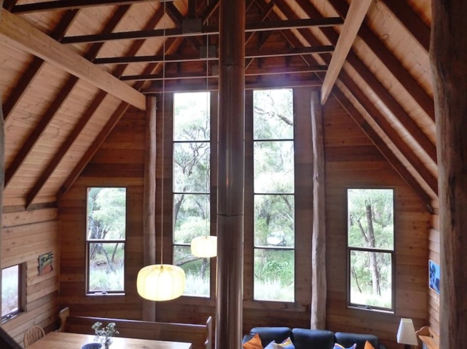 Large soaring wooden roof over living space.