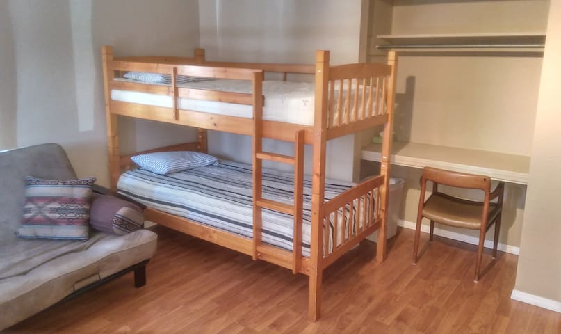 Rent 1 bed per person on this listing in our shared 4 bed dormitory room. 3 private locking bathrooms off the main hallway.