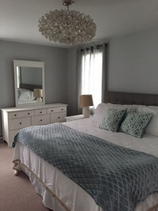 Bedroom is finished in whites, greys and blues. Bed is a king.  Washer/dryer in walk-in closet.