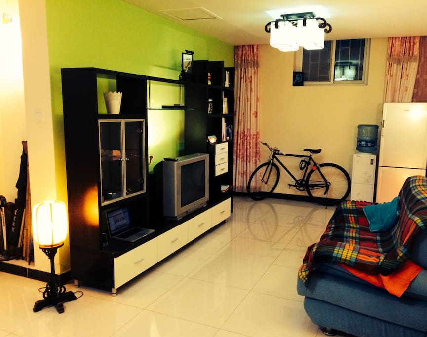 Living room: sofa, TV, guide books, guests are free to use the bicycle.