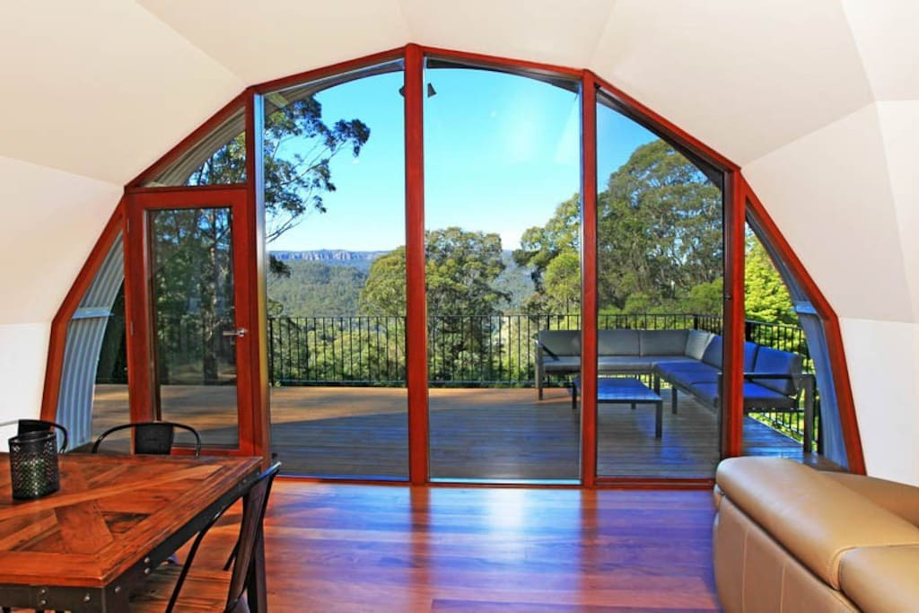 Unique Eco Construction Floor To Ceiling Arched Windows.