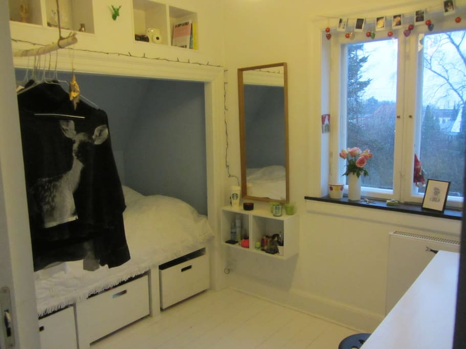 The teenage room with a very charming and comfortable double bed.