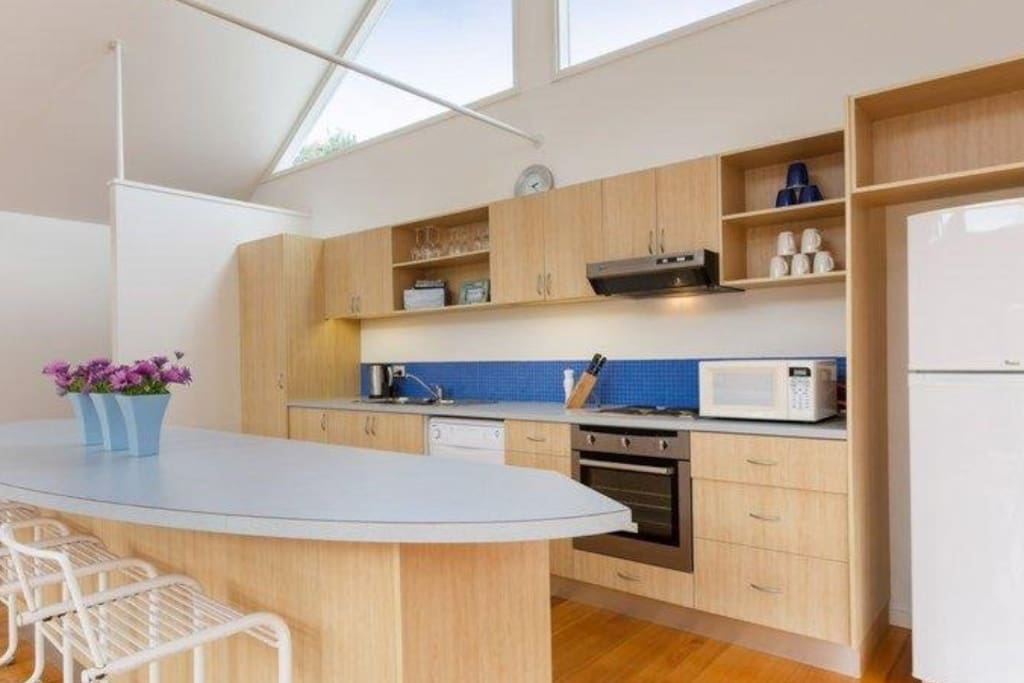 Modern, fully equipped kitchen with stocked pantry.