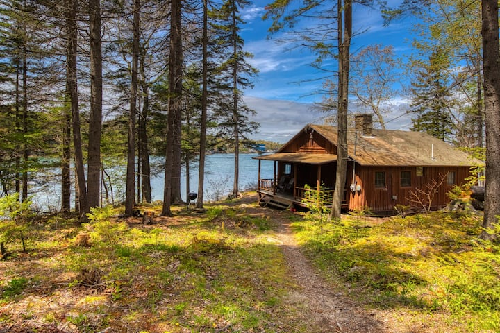 Waterfront cabin w/ ocean view, fireplace, & private dock