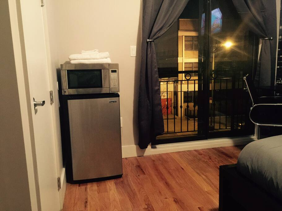Private refrigerator and microwave in room.
