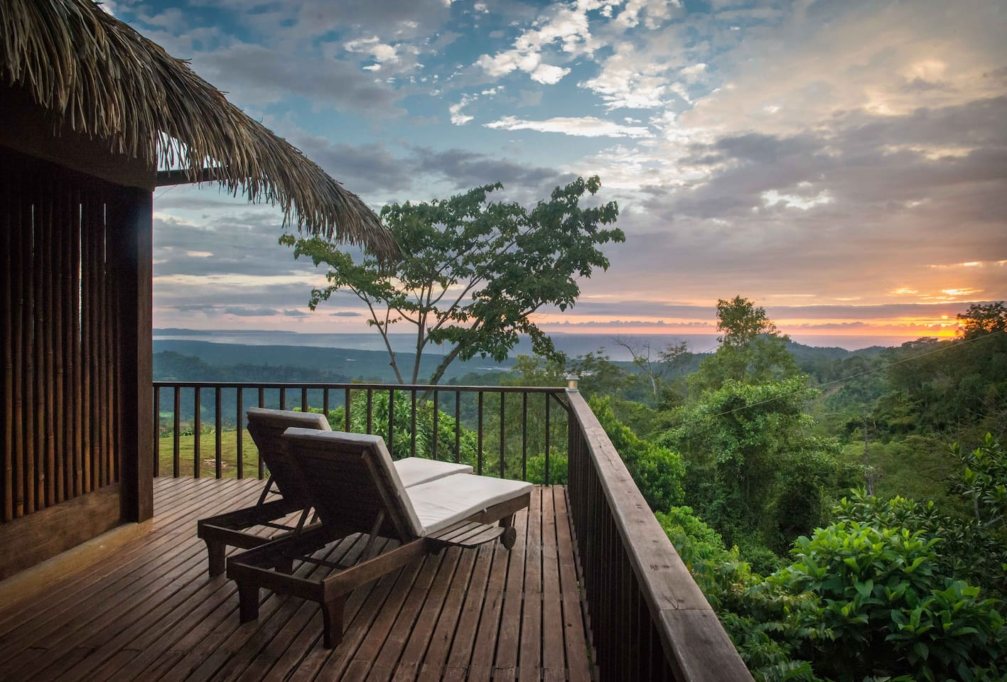 The front corner of the wrap-around balcony hangs over the jungle canopy to the right and offers spectacular sea & valley views straight ahead. A great place for a smoothie and bird & sunset watching from the comfort of one of our teak sun loungers