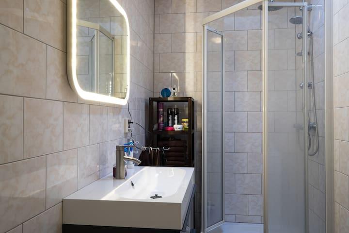 Bathroom; includes washingmachine, föhn and a large sink/ mirror combi