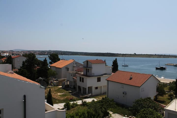 One bedroom apartment with balcony and sea view Novalja, Pag (A-6317-e)