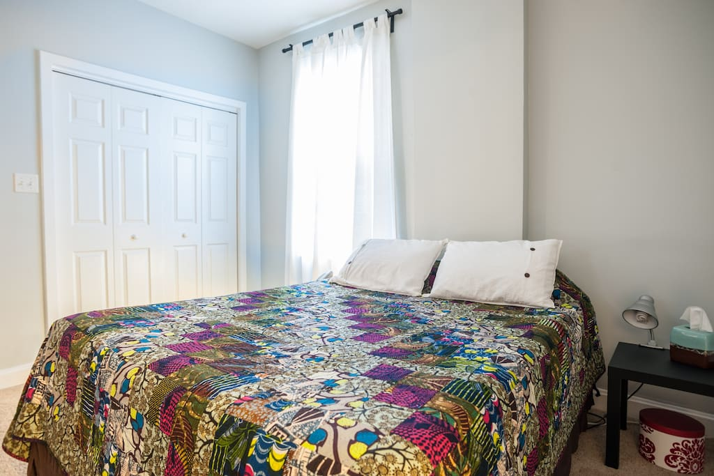 The master bedroom is spacious and peaceful.