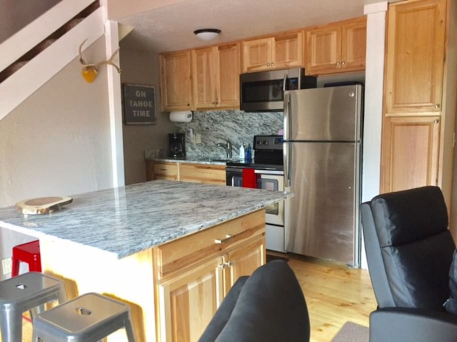 Brand new kitchen. Granite countertops with huge island that seats 8 for meals and conversation! Large screen TV for watching a game or winding down.