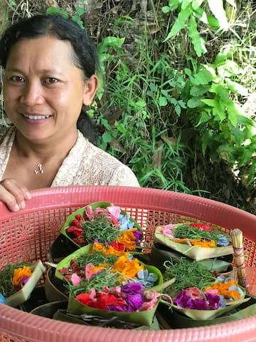 Meet Ibu Yuda, one of our caretakers. She meets you at your arrival and comes to make your bed and clean the house every day and takes care of you during your stay.