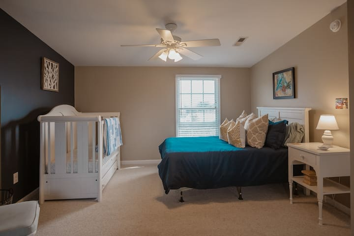 Full sized crib in upstairs bedroom- changing table, baby gates and booster seat are all provided.