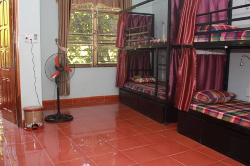 One of the rooms with its cute fan