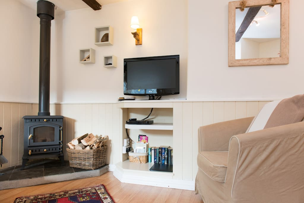 Open plan kitchen/diner sitting area with woodburner