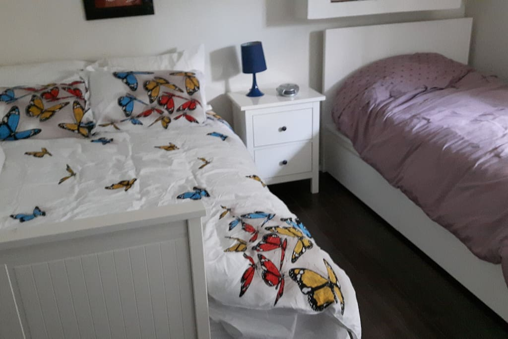 Large bright bedroom with both a double bed and a single bed