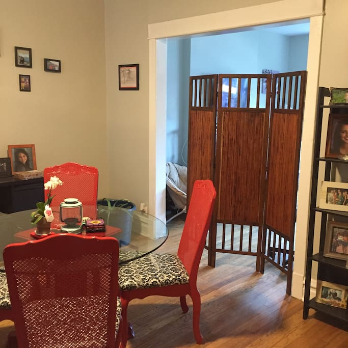 The living room is set off from the rest of the apartment. It is located behind the privacy screen.