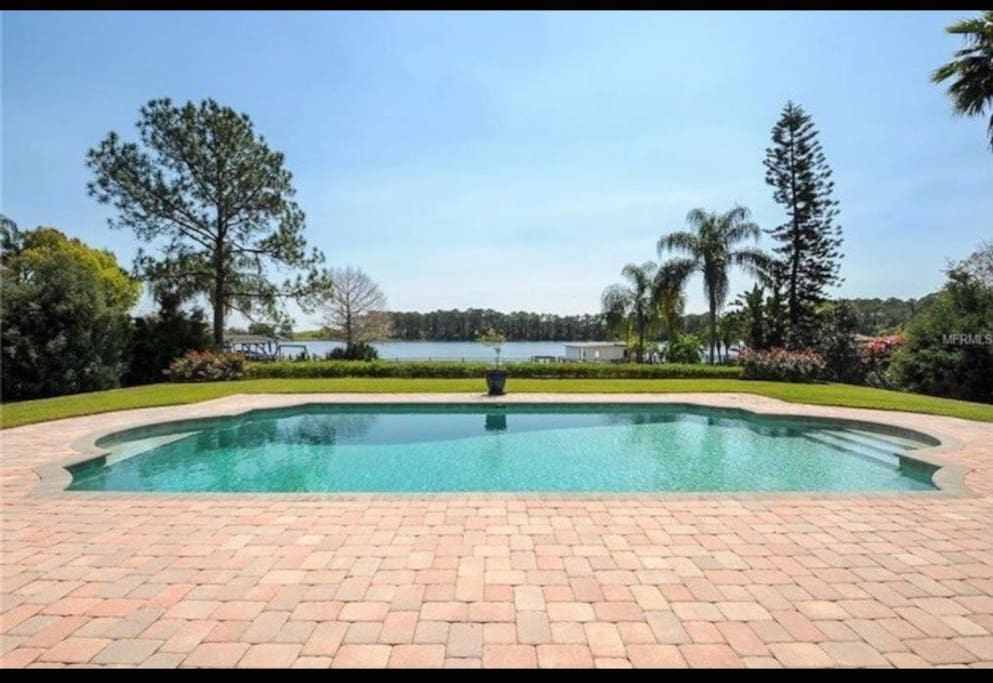 Overlooking the lake is a beautiful pool to enjoy when you need a break from the Florida heat!