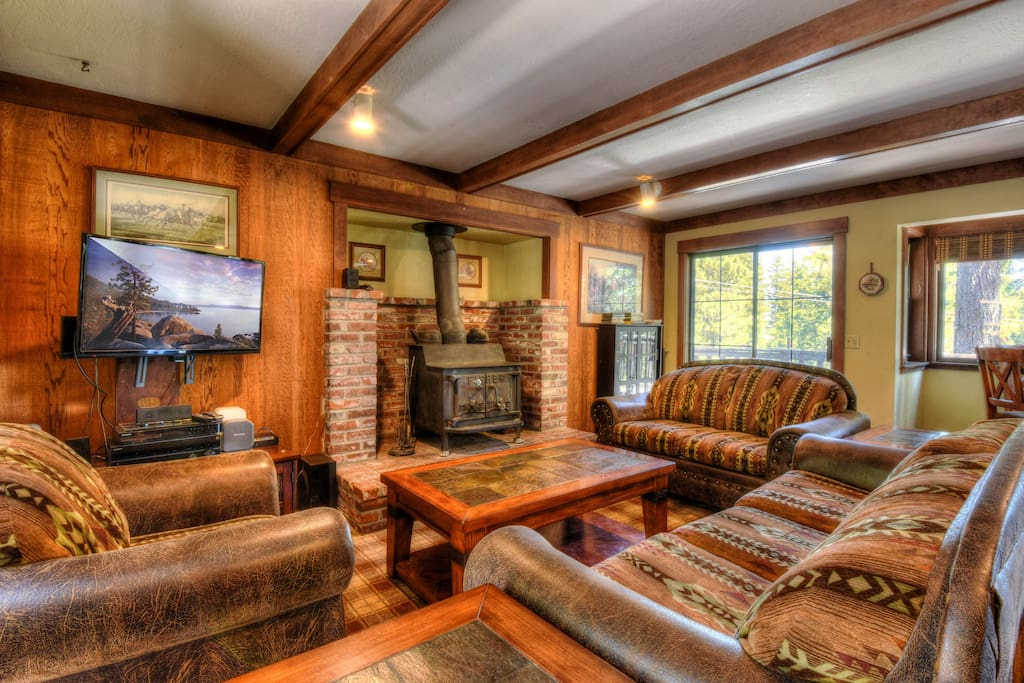 Comfortable living room with a wood burning fireplace and flat screen TV