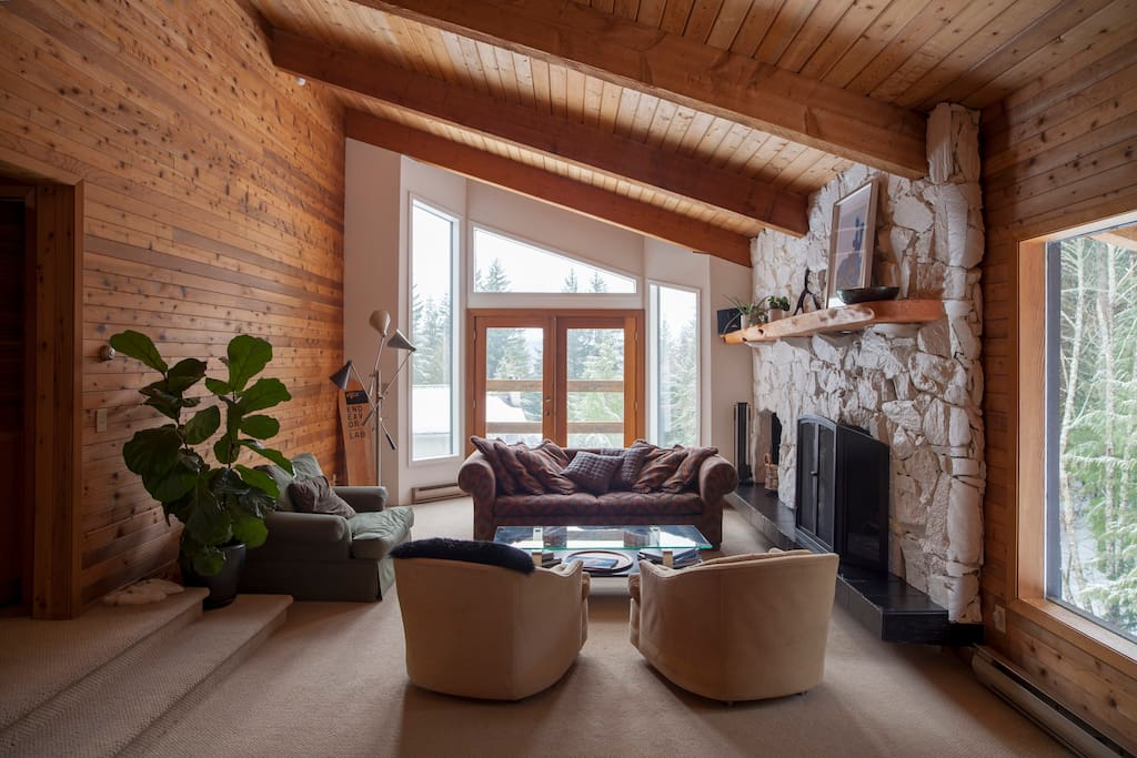 Living Area and wood burning fire place with views of WhistlerBlackcomb and the Peak to Peak gondola.